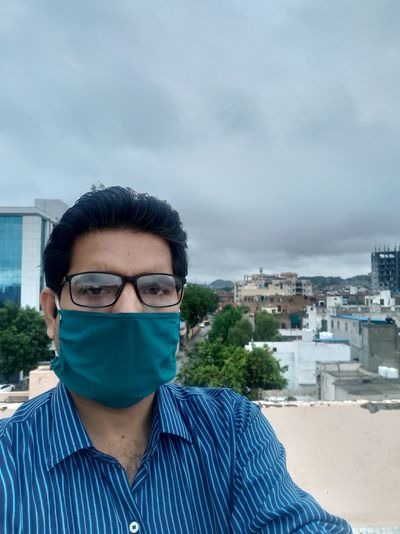 Wearing mask on office roof