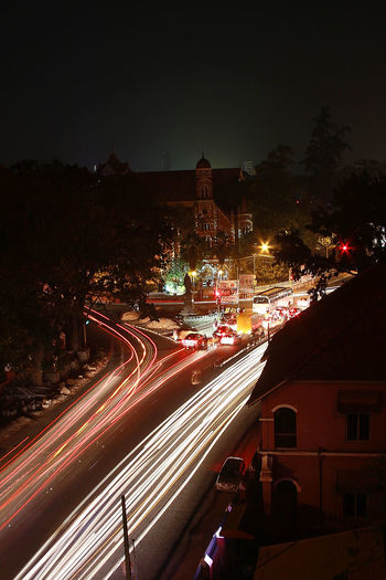 Vantage Point Architecture Car City City City Life City Street Citylights Community Crossroads Intersection Long Exposure Neon Lights Night Outdoors Residential District Road Street Light Thiruvananthapuram Traffic Lights Traffic Stream Trivandrum Vantage Point Photography In Motion Cities At Night On The Way