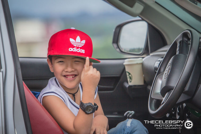 Boys Cap Car Child Childhood Happiness Innocence Land Vehicle Leisure Activity Males  Men Mode Of Transportation Motor Vehicle One Person Outdoors Portrait Real People Sitting Smiling Transportation Vehicle Interior