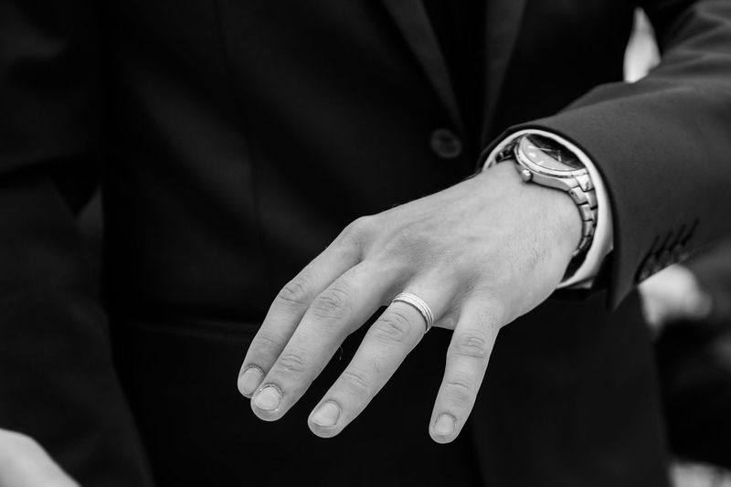 Close-up of the hand of a groom
