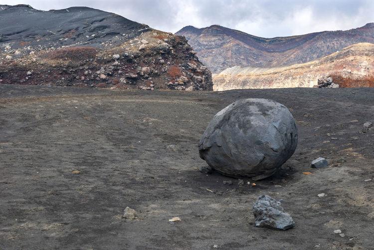 Rock on land against sky