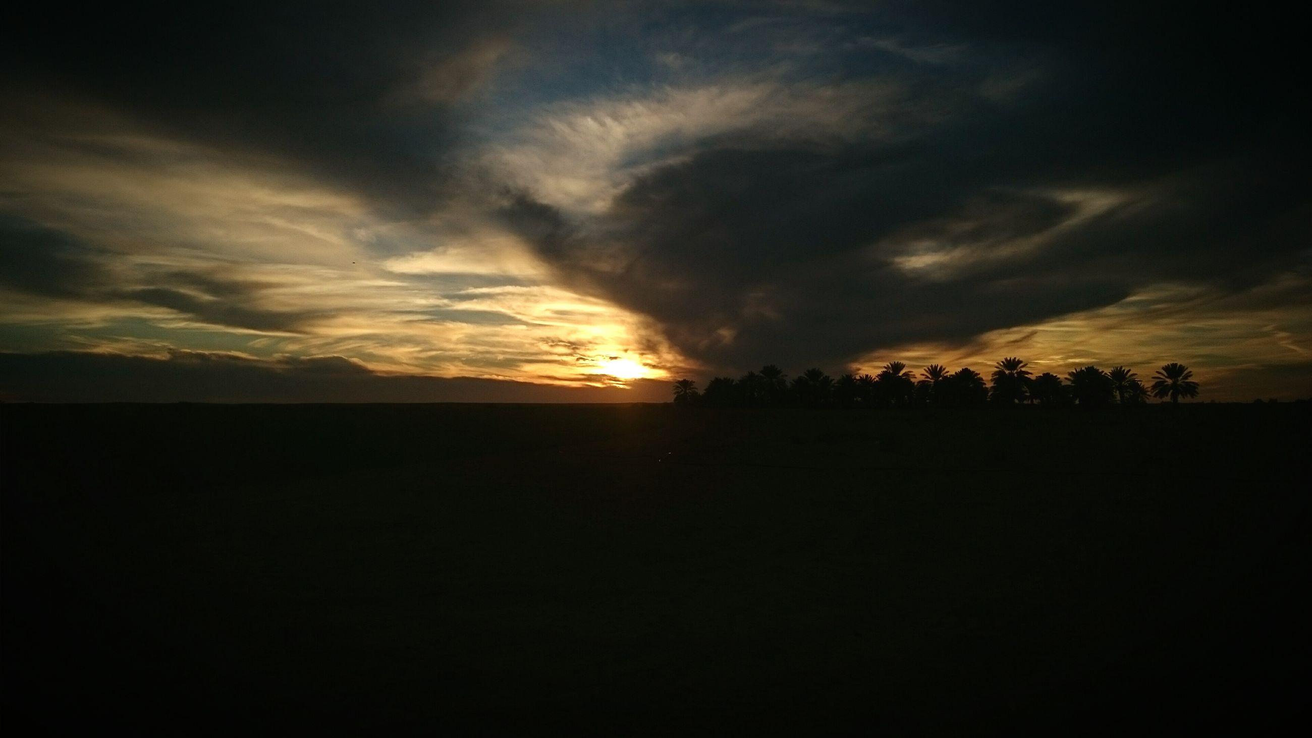 sunset, silhouette, scenics, tranquil scene, sky, tranquility, beauty in nature, cloud - sky, sun, landscape, idyllic, nature, orange color, dramatic sky, dark, cloudy, cloud, atmospheric mood, moody sky, outdoors