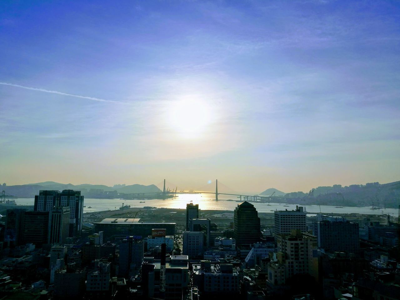 cityscape, architecture, building exterior, city, skyscraper, built structure, no people, sunlight, sky, modern, travel destinations, sunset, outdoors, city life, urban skyline, day, city location