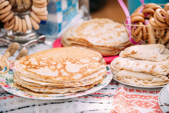 The dishes of the traditional Belarusian cuisine - pancakes. Attribute of traditional folk celebration of Maslenitsa. Belarusian Celebration Holiday Russia Bread Close-up Cooked Cuisine - Pancakes Folk Food Food And Drink Food Stories Maslenitsa Ready-to-eat Slavic Spring Table Traditional