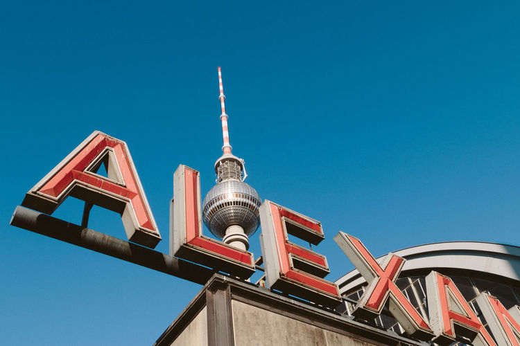Alex Alexanderplatz Architectural Feature Architecture Berln Blue Building Exterior Built Structure City City Life Clear Sky Communication Day Famous Place High Section Low Angle View Multi Colored No People Outdoors Sky