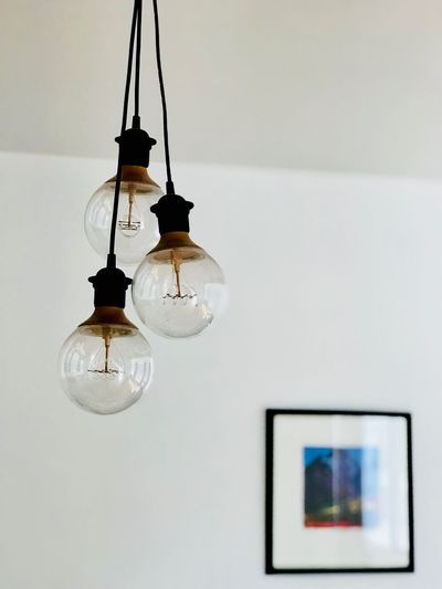 Lamps Hanging Lighting Equipment Indoors  Wall - Building Feature Illuminated No People Ceiling Decoration Pendant Light Low Angle View Light Electricity  Light Bulb Electric Light Home Interior White Color Technology Electric Lamp