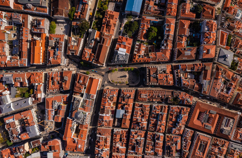 Overhead aerial of red roofs of buildings in historic center of city in lisbon, portugal.