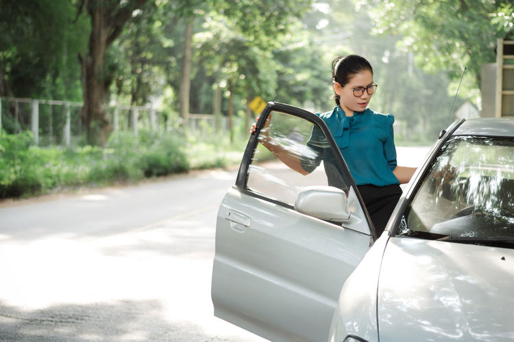 Young Woman Entering In Car