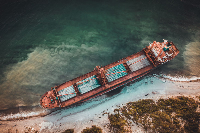 High angle view of abandoned ship sailing in sea