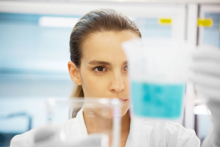 Close-Up Of Young Woman Working In Laboratory