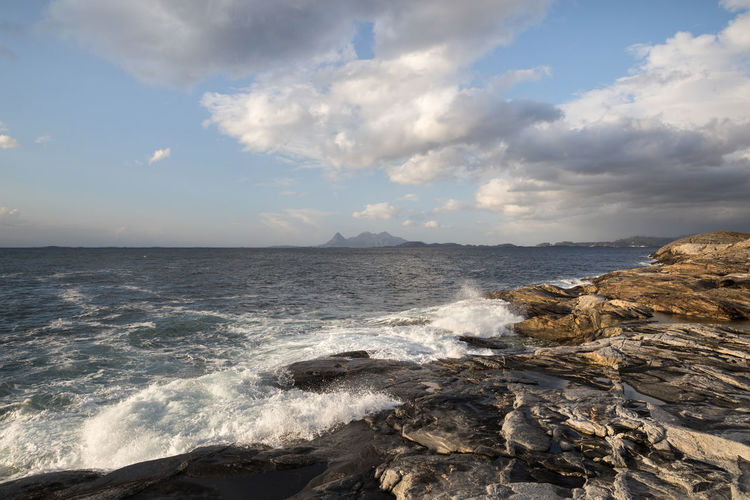 Waves breaking on a rocky seashore Coastline Norwegian Sea Rock Formation Beach Beauty In Nature Cloud - Sky Day Dramatic Landscape Getting Away From It All Horizon Over Water Island Nature No People Outdoors Remote Rock - Object Scenics Sea Sky Splashing Summer Tranquil Scene Tranquility Water Wave