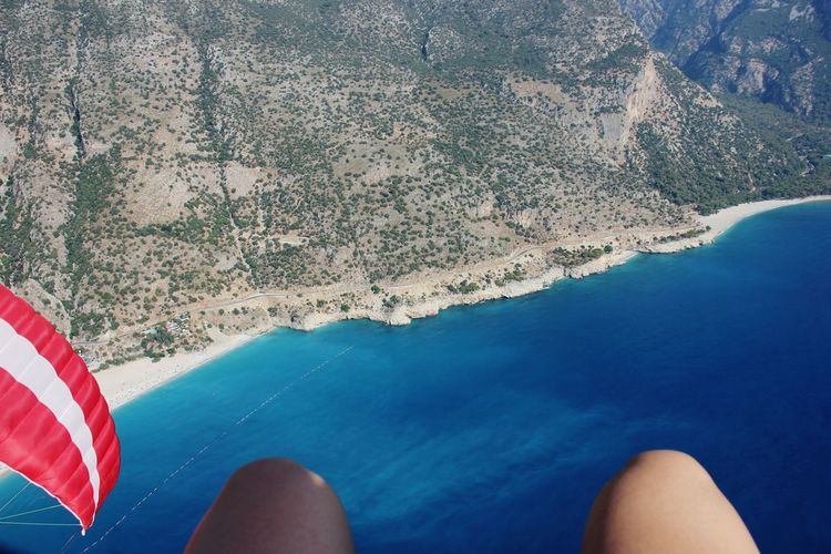 Water Blue Close-up Vacations Outdoors Human Body Part Human Leg Paragliding Flying High Flying Finding New Frontiers Sea Parachute Mountains Legs EyeEm Best Shots Flying High Done That. Perspectives On Nature Be. Ready. Go Higher