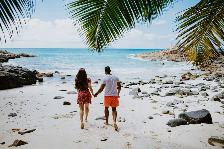couple travel on beach of tropical island. Lovely couple relax on beach with white sand in exotic island. Couple Couple - Relationship Beach Summer Sun Togetherness Love Resort Island Tropical Ocean Sea Relaxing Travel Travel Destinations Leisure Activity Lifestyles Exotic Seychelles Vacations Honeymoon EyeEm Best Shots Water Beauty In Nature Happiness