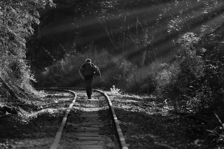 Walking The Line One Person Outdoors Railroad Track Real People Sun Rays The Way Forward Trainline The Street Photographer - 2018 EyeEm Awards