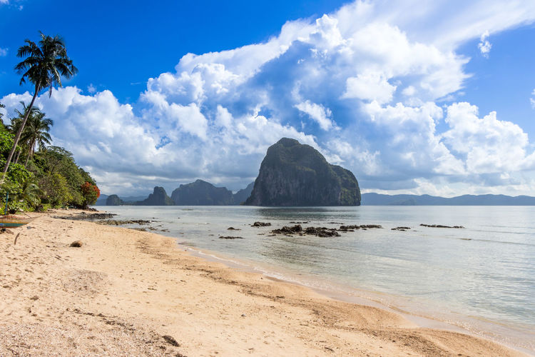 Sky Water Sea Beauty In Nature Land Cloud - Sky Scenics - Nature Tranquil Scene Beach Tranquility Nature Tree Day Idyllic No People Mountain Rock Sand Plant Outdoors Travel Travel Destinations Philippines