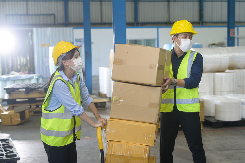 Man working in box by building
