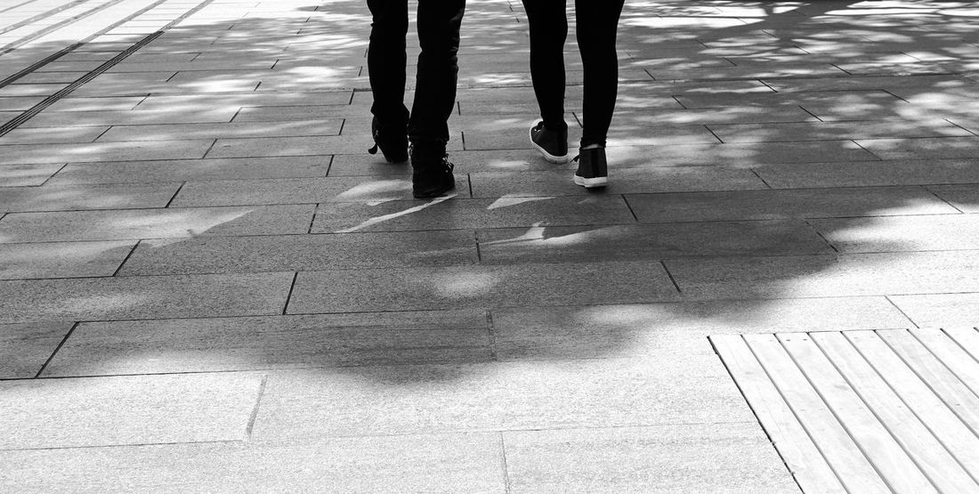 Balck And White Cuople Day High Angle View Human Body Part Human Leg Leisure Activity Lifestyles Low Section Men Outdoors People Real People Shadow Togetherness Adventures In The City Focus On The Story