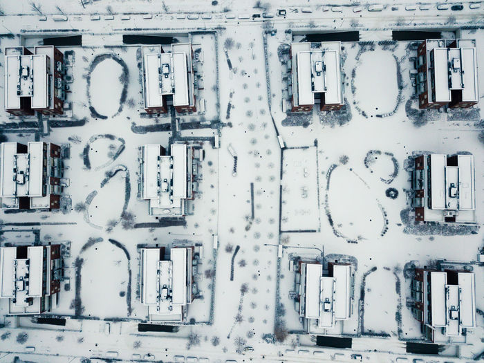 Aerial view of snow covered buildings in city