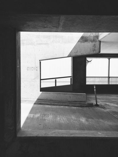 Geometry in parking garage Architecture Built Structure Sunlight Day Building Exterior No People 17.62° Outdoors Railing Window Wall - Building Feature Staircase Transportation City Shadow Road Marking