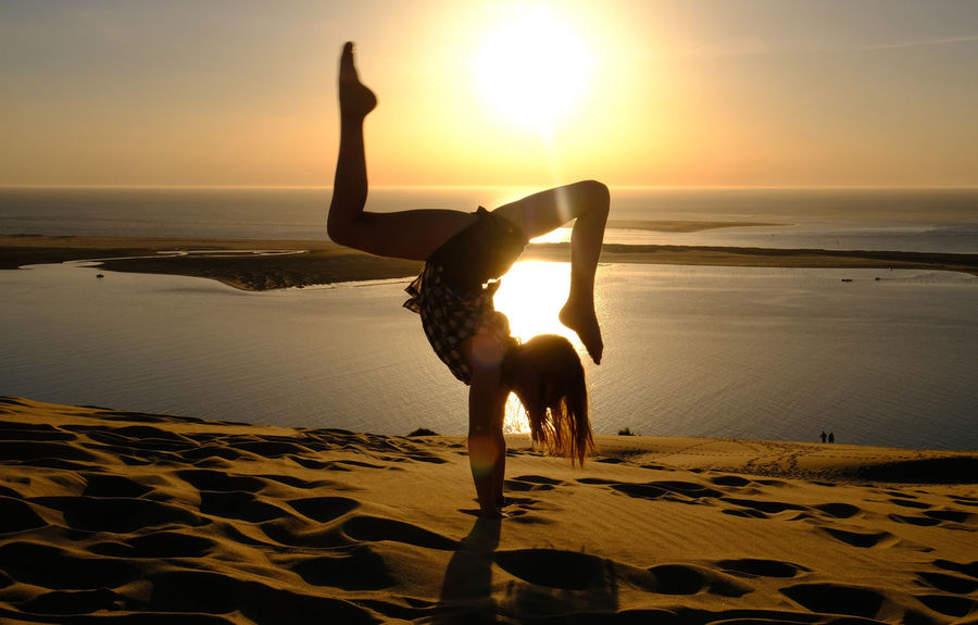 Backbend Beach Dune Du Pilat Arcachon Flexibility France 🇫🇷 Handstand  One Person Sand Sea Sport Sunset Tranquility Water Yoga Yoga Pose First Eyeem Photo