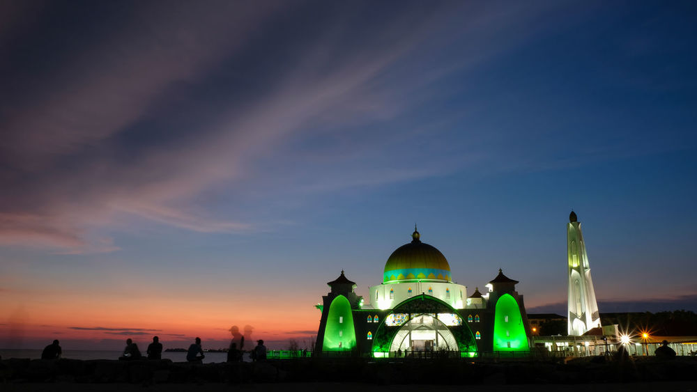 Amazing Strait Mosque of Malacca glowing during sunset. The Mosque is located at the Historical Malacca City, Malaysia. Masjid Selat Sunset Silhouettes Architecture Building Exterior Built Structure Casa Nayafan Dome Glow In The Dark Glowing Mosque Malacca Tourism Nature Outdoors Place Of Worship Praying Religion Sky Spirituality Starit Mosque Of Malacca Sunset Tourism Malaysia Travel Destinations Unesco City Vibrant Color