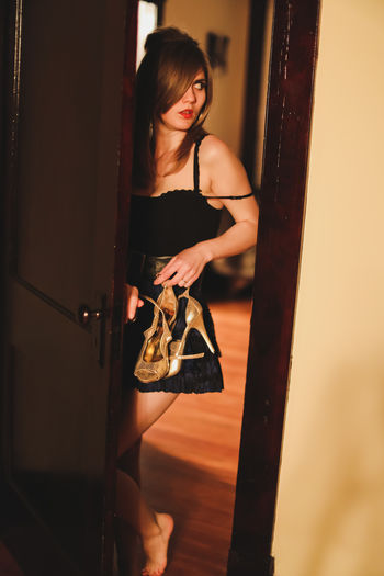 Amy Winehouse Beauty Confidence  Creative Portraits Door Frame Evening Light Front View High Heels Home Is Where The Art Is Leaning Long Hair Night Out Person Portrait Red Lips Sensuality Short Skirt  Sneaking Out Time To Party Vintage Decor Wooden Door Wooden Door Frame Young Adult Young Women