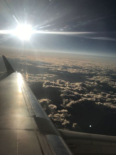 Airplane Sunbeam Nature Sun Transportation Lens Flare Beauty In Nature Scenics No People Aerial View Sky Sunlight Outdoors Airplane Wing Air Vehicle Travel Mode Of Transport Journey Sea Tranquility