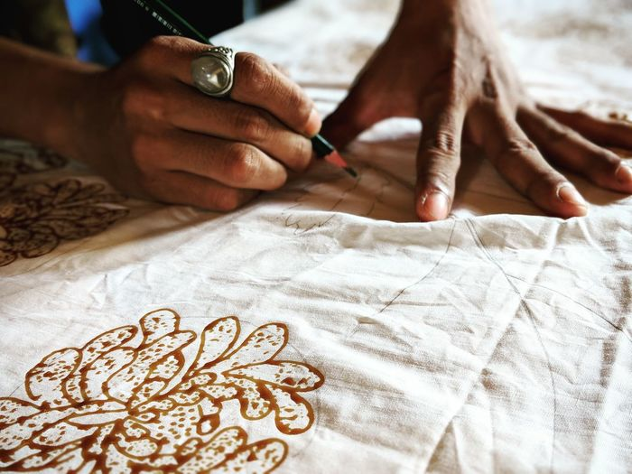 Batik Lesson Exotic Travel Batik BatikIndonesia Wax Artist Art Fabric Travel Destinations INDONESIA Drawing Hands Hands At Work Human Body Part Human Hand Close-up Skill  Working One Person
