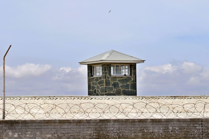 Architecture Built Structure Building Exterior Cloud - Sky Building No People Tower Security Wall - Building Feature Railing Roof Protection Outdoors Safety Wall Prison Camp Robben Island