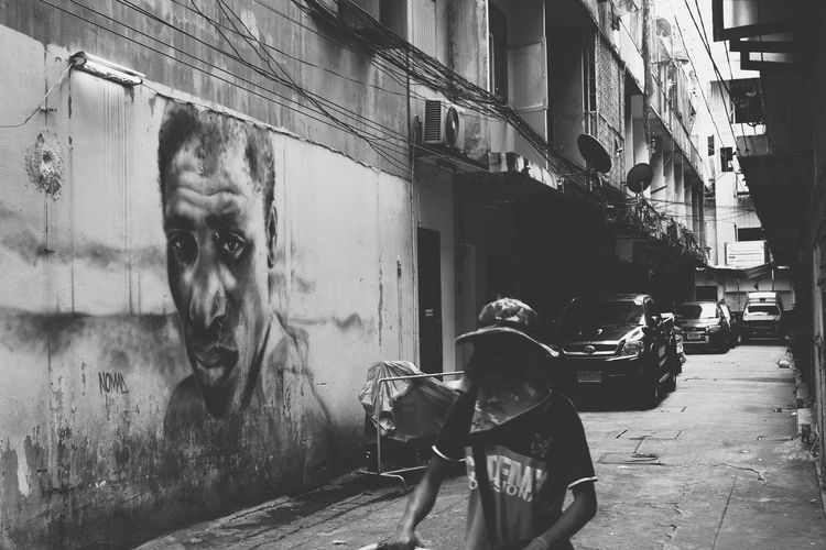 Streetphotography Streetphoto_bw Blackandwhite City Men Architecture Street Art Graffiti Spray Paint Street Street Scene City Street