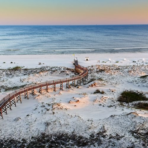 View of the Beach with Wooden Walkway, Beach and Gulf Waters 2 Water Sea Horizon Over Water Horizon Sky Scenics - Nature Beauty In Nature Tranquility Beach Nature Tranquil Scene Land No People High Angle View Idyllic Travel Day Non-urban Scene Tourism Outdoors