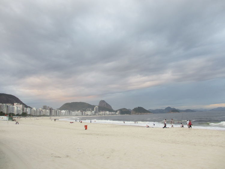 Beach Beauty In Nature Cloud - Sky Cloudy Copacabana Landscapes With WhiteWall Large Group Of People Leisure Activity Mountain Nature Rio De Janeiro Sand Scenics Sea Shore Sky Tourism Tourist Tranquil Scene Tranquility Vacations Water
