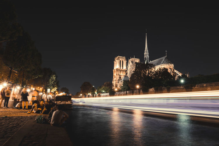 Summer nights in Paris. Architecture Cathedral City Cityscape France Illuminated Night Notre Dame De Paris Paris By Night ParisByNight Passing By River Seine River Traffic Travel Destinations Young People In Paris Embrace Urban Life Enjoy The New Normal Nightlifephotography Paris Night Life An Eye For Travel