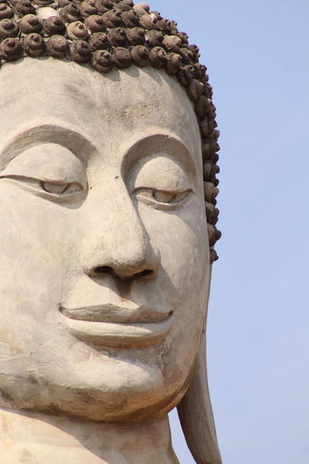 Low angle view of statue of buddha against clear sky