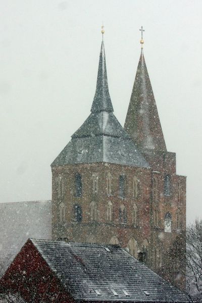Church Architecture Building Exterior Built Structure Church Towers Cold Temperature Day History Low Angle View No People Outdoors Place Of Worship Religion Sky Snow Snowing Spirituality Winter