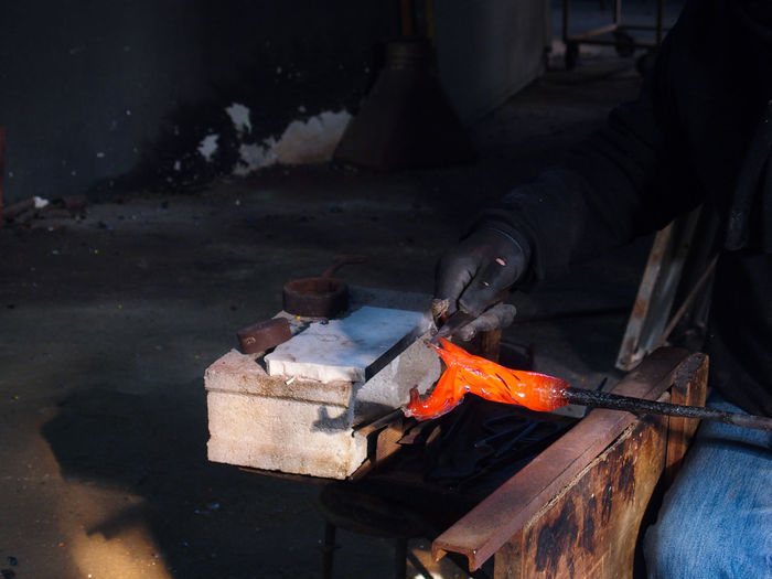 Cropped Image Of Craftsperson Working On Hot Metal