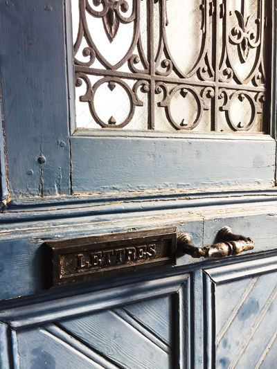 Aged Aged Beauty Aged Wood Animal Themes Architecture Blue Built Structure Day Door Letters Letters Art Mail Mail Box Mailbox Mailboxes Mammal Metal No People One Animal Outdoors Railing Slot Wall Wall - Building Feature Wood - Material