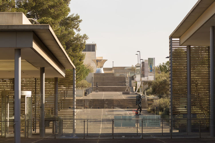 Modern buildings against clear sky in city