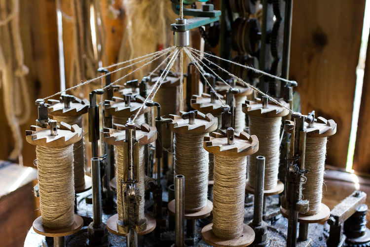 Making ropes the old way. Arrangement Close-up Craftsmanship  Handmade Machine Part Machinery Making Rope Old Part Of Repetition Rope Ropemaker Selective Focus Side By Side Spinning Technical Detail Technology Work Tool