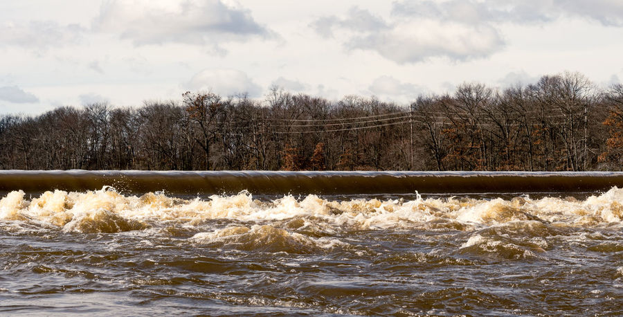 The South River at Duhernal Dam in Old Bridge, New Jersey after a Noreaster Flooding River New Jersey Beauty In Nature Cloud - Sky Day Duhernal Flooding Motion Nature No People Noreaster Outdoors Power In Nature River Scenics Sky South River The South River Tree Water Wave
