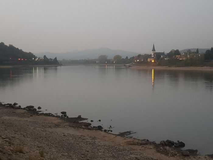 Scenic view of lake against clear sky at dusk