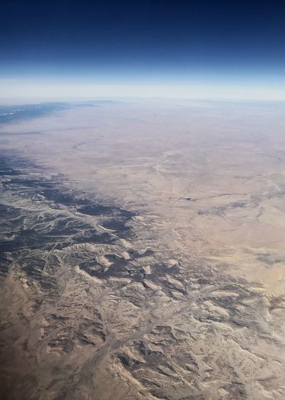 Desert landscape at 35,000 ft. Curvature Of The Earth Arid Landscape Desert Landscape Landscape Rugged Landscape Erosion Arid Landscape Desert Colors Desert Nature Aerial View Scenics Tranquility Beauty In Nature Tranquil Scene Landscape The Natural World Physical Geography View Into Land Arid Climate Sky Outdoors Day