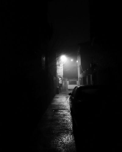 Empty narrow street in old town at night