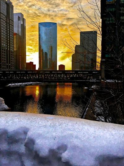 Sunset over a snowy Chicagoland and Chicago River in winter. Chicago Chicago El Chicago Loop Cityscape Downtown Chicago Elevated Track Reflection Snow ❄ Tree Winter Architecture Bridge - Man Made Structure Building Exterior Built Structure City Cold Temperature Day Elevated Train Outdoors Sky Snow Sunset Tower Water Winter Colour Your Horizn