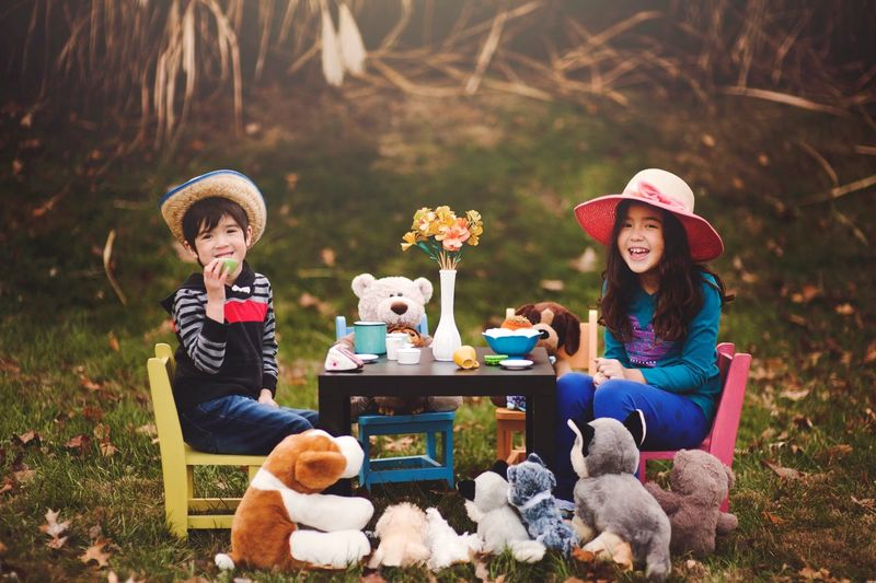 Brother and sister Tea Party with stuffed animals. Sitting Friendship Child Looking At Camera Childhood Children Only Cute Two People Brother Togetherness Portrait Food And Drink Outdoors Cheerful Teapot Happiness Animal Son Boy Happiness Innocence Asian  Hanging Out Beauty Uniqueness