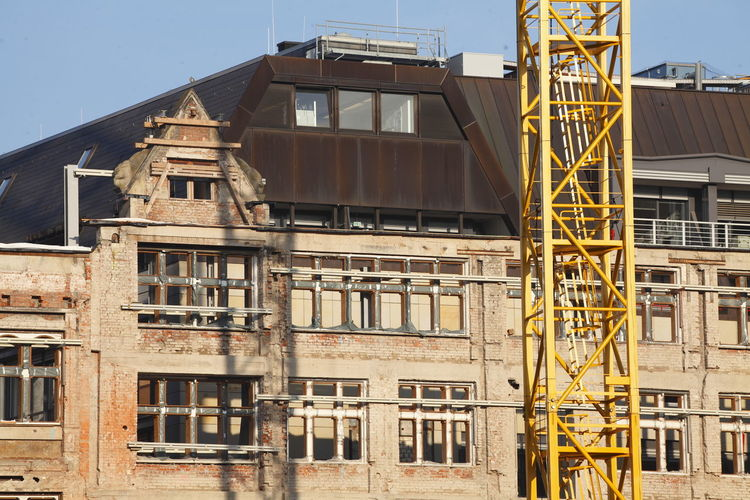 House, Construction Site Bremer Landesbank, Scaffolding,, Bremen, Germany Architecture Bremen Bremer Landesbank Building Exterior Built Structure Business Finance And Industry Construction Construction Site Crane Crazy Day House Industry No People Outdoors Scaffolding Sky