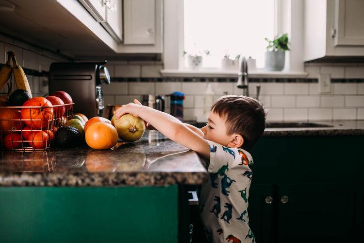 Full length of boy on apple at home