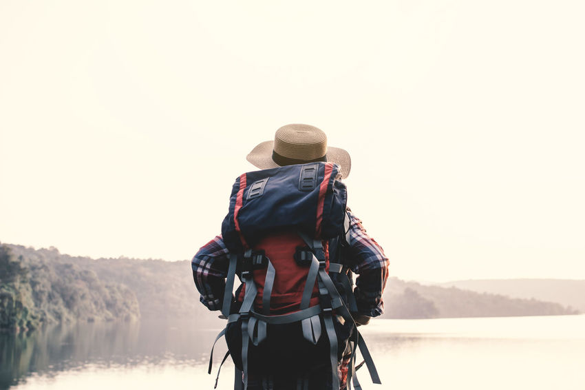 Backpack Lake Lifestyles Looking At View Nature Real People Sky