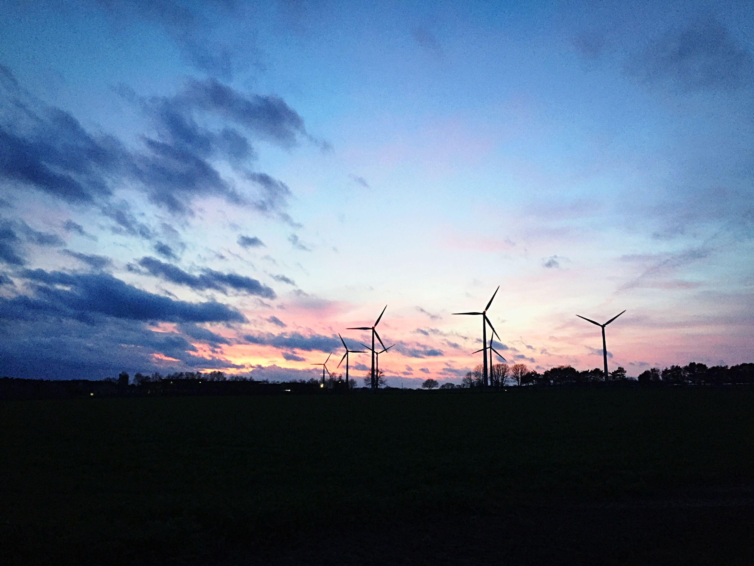 fuel and power generation, wind turbine, wind power, silhouette, technology, environmental conservation, electricity pylon, alternative energy, windmill, sky, renewable energy, sunset, landscape, electricity, power supply, field, power line, cloud - sky, tranquility, tranquil scene