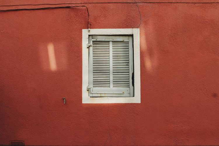 White windows on a red wall